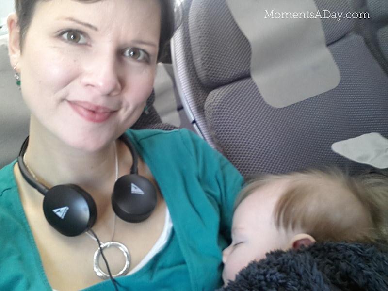 Enjoying Qantas flight with sleeping baby