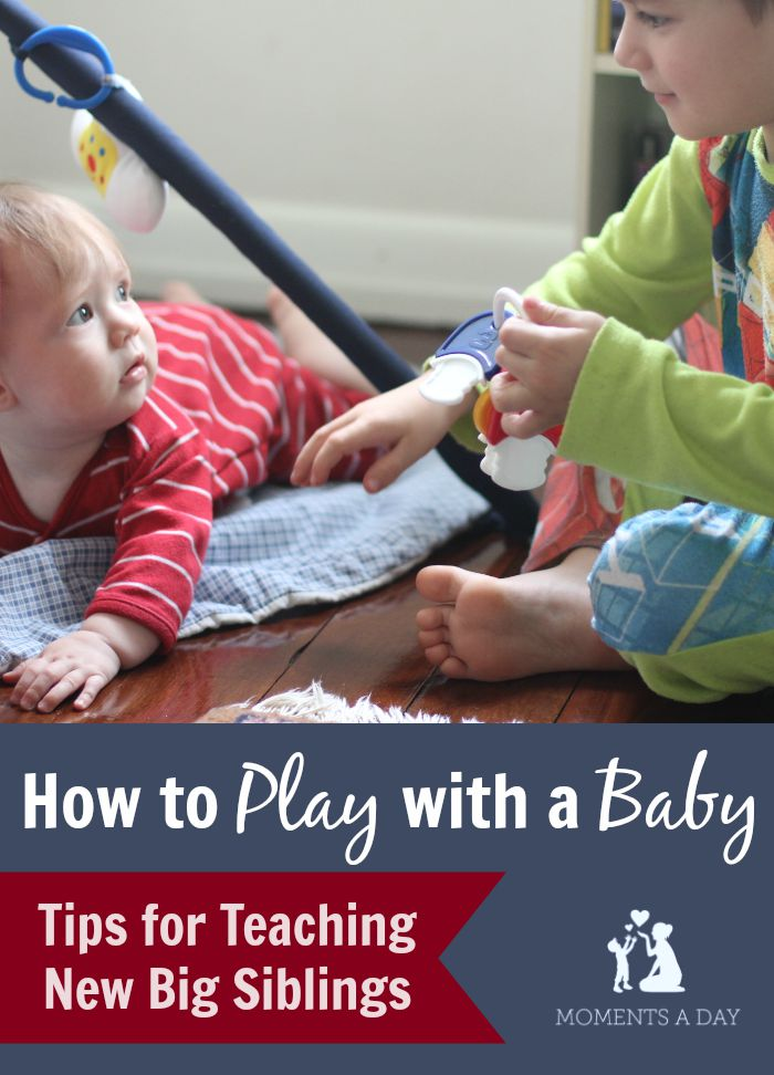 Teaching big brothers and sisters how to play with the new baby